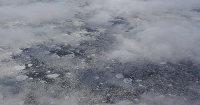 Aerial Through Clouds Barren Frozen Alaska Landscape