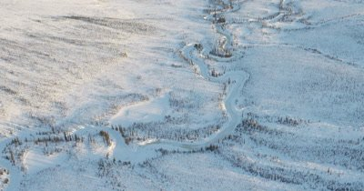 Aerial Over Frozen River in Alaska Winter Landscape
