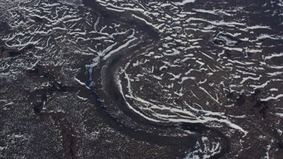 Aerial ,frozen inhospitable landscape,snow makes strange patterns