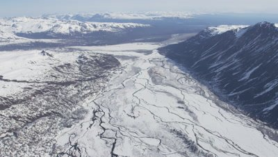 Aerial Over Frozen River,Tributaries In Snowy Mountain Range