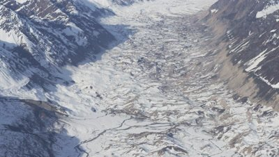 Aerial Over Frozen Valley,River,Tributaries In Snowy Mountain Range