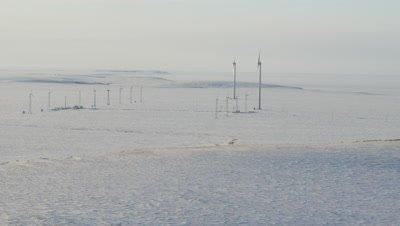 Aerial,Wind Turbines On Snow-covered Tundra Landscape