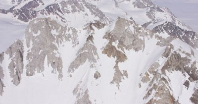 Slow Aerial Close To snow-Covered,Very Rugged Mountain Peaks