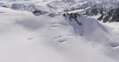 Aerial Through Snow-Covered Rugged Mountains of Alaska