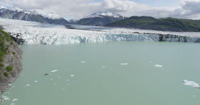 Low POV Aerial Over Icebergs In Glacier Bay,Reveal Wide View of Glacier