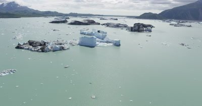 ow Aerial Over Bay,Tilt for Wide View,Travel Very Low Over Iceberg