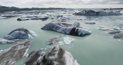 Low POV Aerial Close to Icebergs In Glacier Bay National Park,Tilt for Wide View of Area