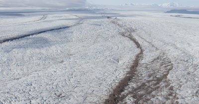 Aerial Over Glacier,Ice Field with Patterns and Debris in Ice