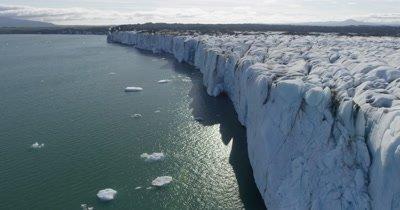 Aerial Along Steep Edge of Coastal Glacier