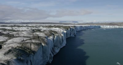 Aerial alomg Steep Edge of Coastal Glacier