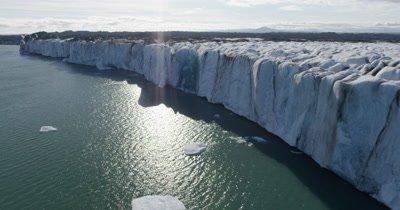 Aerial Over Ice Top To Steep Edge of Coastal Glacier