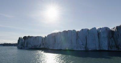 Low,Close Aerial Along Steep Edge of Coastal Glacier