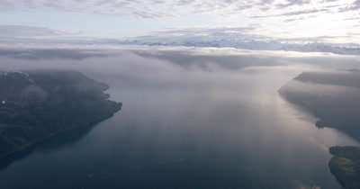 Wide Aerial Through Low Clouds,Overlooking Rugged Alaska Coast