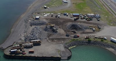 Aerial Over Construction Site,Gravel piles on coast