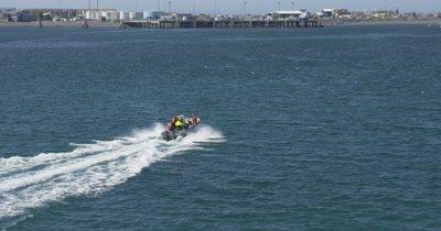 Aerial Single Motor Boat Travels in Open Water