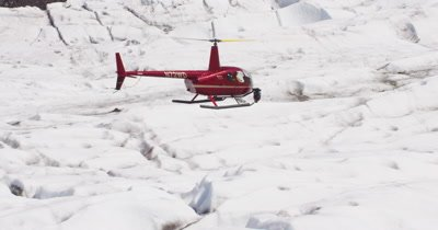 Aerial View of Helicopter With Heligimbal Camera Flying Low Over Glacier