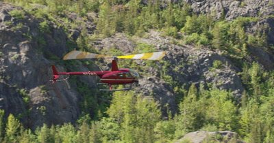 Aerial View of Helicopter With Heligimbal Camera Flying Over Alaska