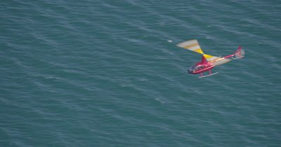 Aerial View of Helicopter With Heligimbal Camera Flying Over Water