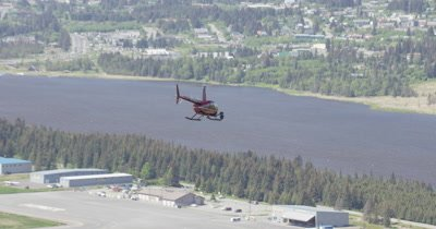 Aerial View of Helicopter With Heligimbal Camera Comes in for a Landing at Airport