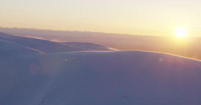 Aerial Over Mountains Covered in Heavy Snow,Snow Blows in Wind