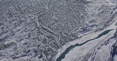 UHD aerial of knik arm river valley of immense number of meandering streams and amazing patterns from frozen river paths