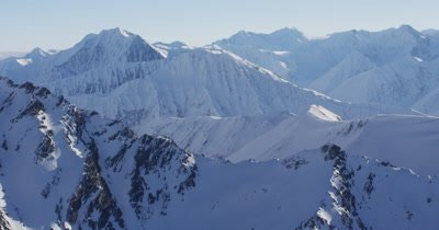 Expansive Aerial View Over Snow-Covered Mountains of Alaska