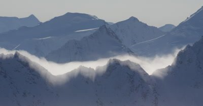 Aerial Through Low Clouds,Rugged Alaska Mountain Peaks in Winter