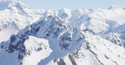 Aerial Grand Vista of Alaska Mountain Range Covered in Snow