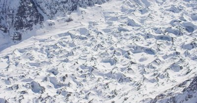 Low Aerial Over Mountains Blanketed By Deep Snow,Distinct Pattern,Shadows