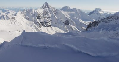 Very Low,POV Aerial Over Deep Chunky Snow,Crevices, Glacier,Tilt to Reveal Wide Vista