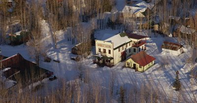 Aerial Over Historic Mining Town of McCarthy,Circle around Hotel