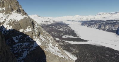 Aerial Very Close to Sheer Rock Walls with View of Frozen River Below