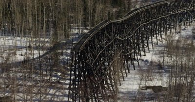 UHD aerial of ancient wooden train trestle old mining McCarthy Alaska