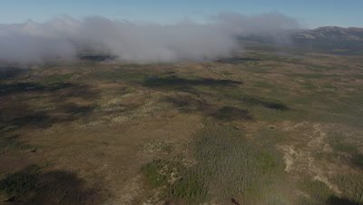Aerial Over Flat,Desolate Alaska Landscape with Low Clouds