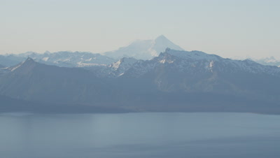 Aerial,Alaska Coastline with Large,Snow-capped Mountain Range