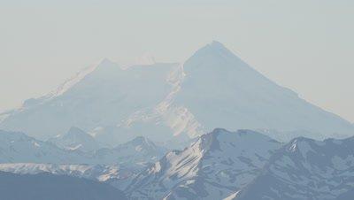 Aerial,Close up Snow-capped Mountain Peak in Haze