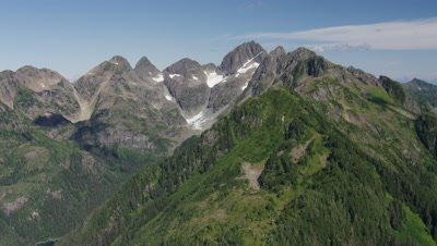 Aerial Alaska,Low over Rugged Mountain Range with patches of snow
