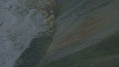 Aerial Alaska,Herd of Caribou Descend Rust-Colored Slope to Dry River Bed