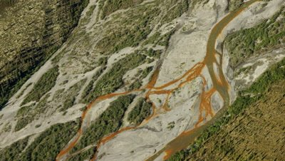 Aerial Alaska,Follow Above Dry River Bed with colorful deposits (minerals?)
