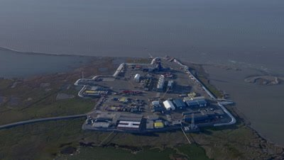 Aerial Coastal Alaska,Wide View of Industrial Complex on Shore,Possibly Oil Production Facility