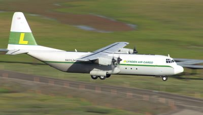 Aerial Alaska,Lynden Air Cargo Plane Flies over oil pipelines