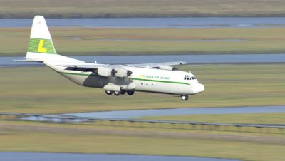 Aerial Alaska,Lynden Air Cargo Plane Flies over oil pipelines,descends for landing