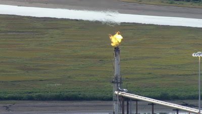 Aerial Alaska,Oil Production Facility with Natural Gas Burnoff Flames
