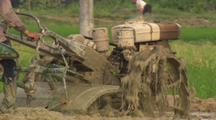 Tilt Up To Reveal Tractor Working Chinese Rice Field Burning Oild Industrialization