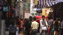 Crowded Chinese Retail Scene Man On Bicycle People Walking