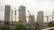 Beijing China Massive Development Cranes Pan Across Growing City Skyline