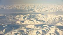 Aerial Of Arctic National Wildlife Refuge And Brooks Range Mountains Alaska Shot Through Plane Window
