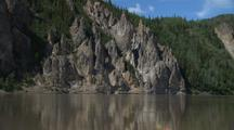 Tilt From Rose Bush To Dramatic Geologic Rock Formations Across Yukon River