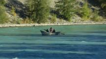 Fishermen Floating Down Blue River In Alaska In Dory