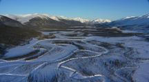 Aerial Forward Looking Over Frozen Valley Alaska Brooks Range Ragged Snow Covered Mountains Gates Of The Arctic Alaska Dramatic Scenery